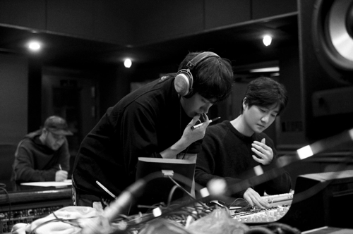 Epik High are pictured working in a studio in this photo provided by YG Entertainment (Yonhap)