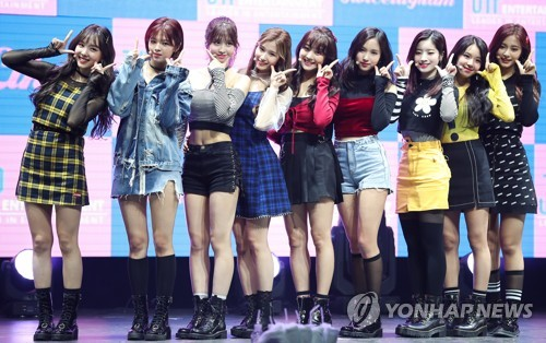 """TWICE poses for photographers during a media showcase for """"Twicetagram"""" at Yes24 Live Hall in eastern Seoul on Oct. 30, 2017. (Yonhap)"""