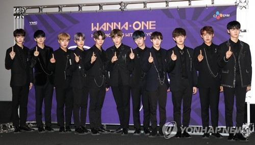 "K-pop project boy group poses for photos before a press conference for its repackaged album ""1-1=0 Nothing Without You"" in the CGV in Yongsan, Seoul, on Nov. 13. (Yonhap)"