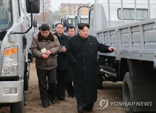 North Korean leader Kim Jong-un inspects a car factory in South Pyongan Province in this photo provided by the North's official news agency KCNA on Nov. 21, 2017. (For Use Only in the Republic of Korea. No Redistribution) (Yonhap)