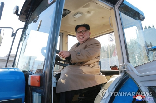 North Korean leader Kim Jong-un smiles inside a tractor during his visit to the Kumsong Tractor Factory in Gangso, South Pyongan Province, in a photo released by the North's official news agency KCNA on Nov. 15, 2017. (For Use Only in the Republic of Korea. No Redistribution) (Yonhap)