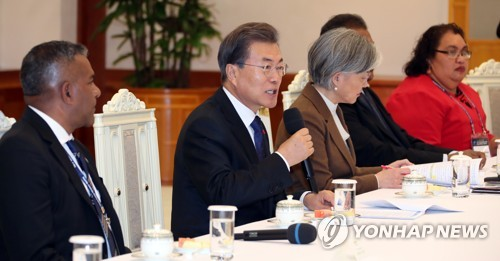 South Korean President Moon Jae-in (second from L) speaks in a meeting with the foreign ministers of 13 Pacific island countries at his office Cheong Wa Dae in Seoul on Dec. 5, 2017. (Yonhap)