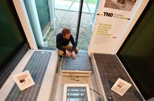 Stan Klerks, lead engineer of the SolaRoad project, examines a prototype solar module at a TNO office in Delft, Netherlands. (Yonhap)