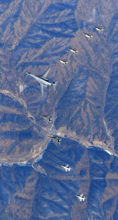 A U.S. supersonic B-1B bomber flies over Korea, flanked by several other warplanes of the allies, on Dec. 6, 2017, in this photo provided by South Korea's Air Force. (Yonhap)