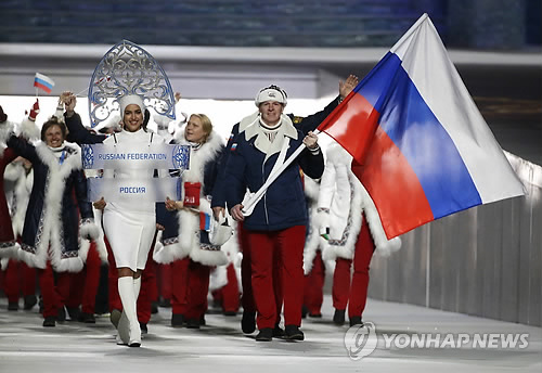 In this Associated Press photo taken Feb. 7, 2014, members of the Russian delegation enter Fisht Olympic Stadium for the opening ceremony of the 2014 Sochi Winter Olympics. The International Olympic Committee banned Russia from the 2018 PyeongChang Winter Olympics over state-sponsored doping on Dec. 5, 2017, allowing only a select few athletes to compete as neutrals if they meet strict conditions. (Yonhap)