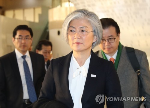 This photo, taken Dec. 19, 2017, shows South Korean Foreign Minister Kang Kyung-wha leaving for Japan for talks over North Korea's nuclear issue and bilateral ties. (Yonhap)