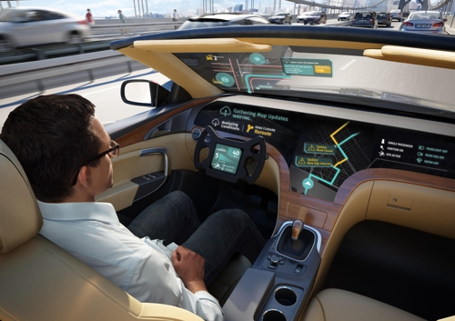 This photo, released by LG Electronics Inc. on Dec. 27, 2017, shows a computer-generated image of how the company's envisioned connected-car solution developed with HERE Technologies may look on a self-driving automobile. (Yonhap)