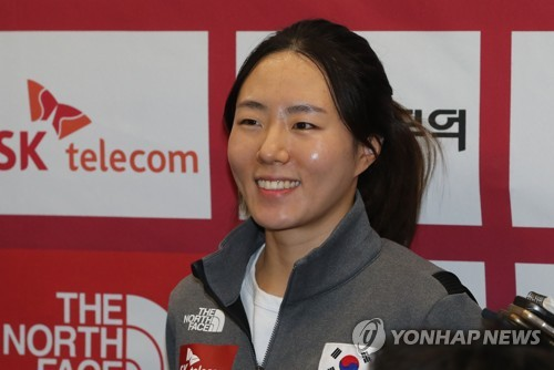 In this file photo taken on Dec. 12, 2017, South Korean speed skater Lee Sang-hwa listens to a reporter's question at Incheon International Airport after returning home from Salt Lake City, Utah, where she competed at the International Skating Union World Cup Speed Skating. (Yonhap)