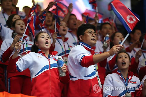 This file photo taken on Sept. 27, 2014, shows North Koreans supporting their athletes in the men's wrestling competition at the Asian Games in Incheon. (Yonhap)