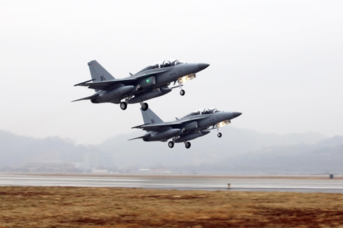 In this photo taken Jan. 8, 2017, and provided by the Korea Aerospace Industries Co. (KAI), two advanced T-50TH trainer jets take off for Thailand. (Yonhap)