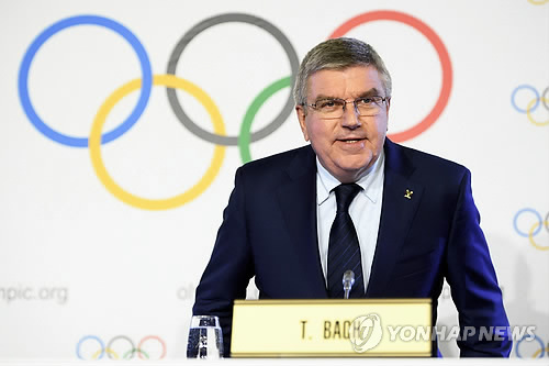 In this EPA file photo taken Dec. 6, 2017, International Olympic Committee President Thomas Bach speaks at a press conference at the IOC headquarters in Lausanne, Switzerland. (Yonhap)