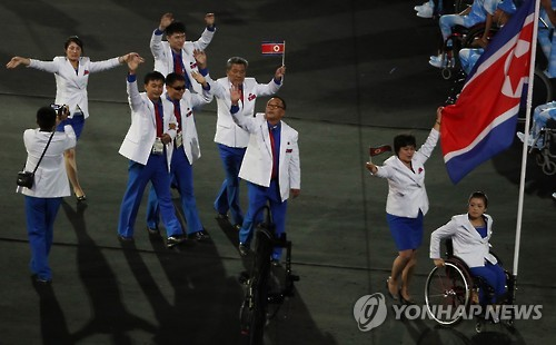 The North Korean delegation waves at the opening ceremony of the 2016 Summer Paralympics in Rio, Brazil, in this file photo taken on Sept. 8, 2016. (Yonhap)