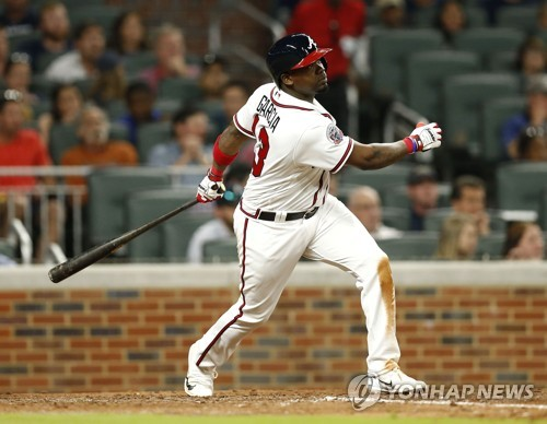 In this Getty Images file photo taken on May 1, 2017, Adonis Garcia, then of the Atlanta Braves, hits a sacrifice fly against the New York Mets in the sixth inning of their major league regular season game at SunTrust Park in Atlanta. Garcia signed with the South Korean club LG Twins on Jan. 13, 2018. (Yonhap)