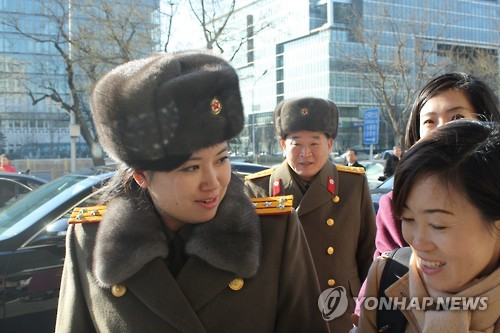 In this file photo taken Dec. 11, 2015, Hyon Song-wol (L), leader of North Korea's all-female Moranbong Band, is seen arriving at a hotel in Beijing. (Yonhap)
