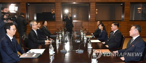 This photo, provided by Seoul's unification ministry on Jan. 15, 2018, shows South and North Korea's holding of working-level talks on the North's plan to send an art troupe to the South during next month's PyeongChang Winter Olympics. (Yonhap)