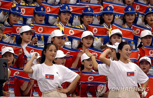 In this file photo taken Oct. 1, 2002, members of a cheering squad from North Korea show support for their athletes at the 2002 Asian Games in Busan. (Yonhap)