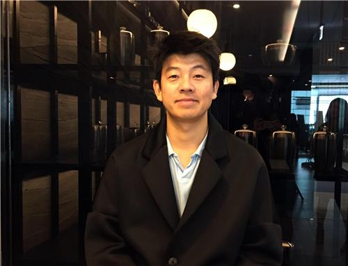 Chef Yim Jung-sik poses for a photo during an interview with Yonhap News Agency at his new restaurant at Incheon International Airport, west of Seoul, on Jan. 17, 2018. (Yonhap)