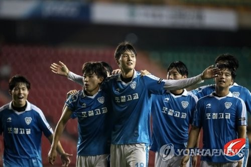 This photo, provided by the K League, shows players from Pohang Jecheol High School football team, which is also the under-18 side of South Korean pro club Pohang Steelers, celebrate after they beat Pungsaeng High School 2-0 to win the K League U-18 Championship in Pohang, North Gyeongsang Province, on Aug. 4, 2017. (Yonhap)