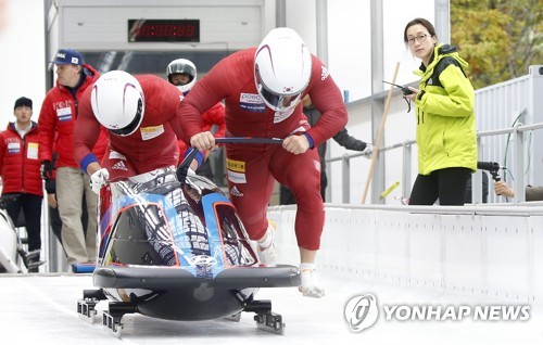 This file photo taken Oct. 18, 2017, shows South Korean bobsleigh team of Won Yun-jong and Seo Young-woo making a practice run at the Olympic Sliding Centre in PyeongChang, Gangwon Province. (Yonhap)