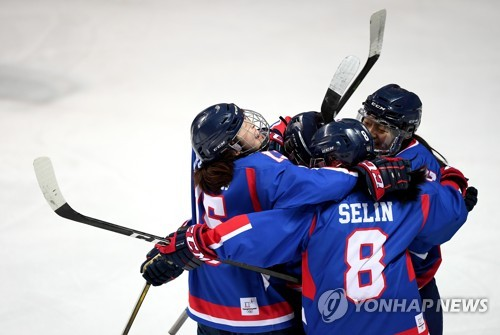 In this Joint Press Corps photo, joint Korean hockey team players celebrate after captain Park Jong-ah scored a goal against Sweden in an exhibition game at Seonhak International Ice Rink in Incheon on Feb. 4, 2018. (Yonhap)