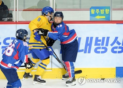 In this Joint Press Corps photo, North Korean forward Ryo Song-hui, playing for the joint Korean women's team, checks Annie Svedin of Sweden during their exhibition game at Seonhak International Ice Rink in Incheon on Feb. 4, 2018. (Yonhap)