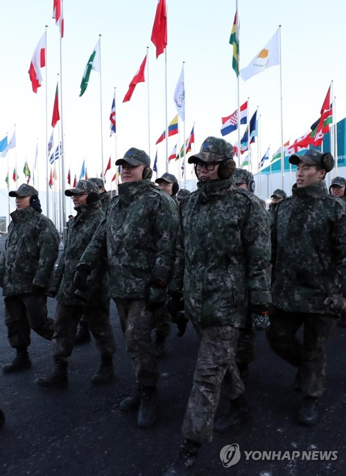 In this file photo, a group of enlisted soldiers enters the Olympic Village for the PyeongChang Olympics in Gangneung, Gangwon Province, on Feb. 5, 2018, to conduct a security check. (Yonhap)