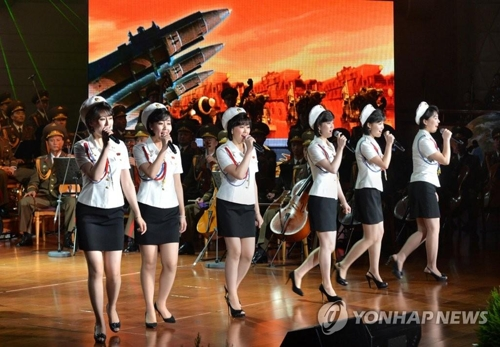 A file photo from Uriminzokkiri shows North Korean singers from Moranbong Band and the State Merited Chorus of the DPR Korean People's Army performing together in 2017. (For Use Only in the Republic of Korea. No Redistribution) (Yonhap)