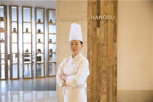 In this undated photo provided by Haevichi Hotel & Resort, Ha Jin-ok, head chef for the hotel's Korean fine dining restaurant Hanoru, poses for a photo at the hotel on the country's southern resort island of Jeju. (Yonhap)
