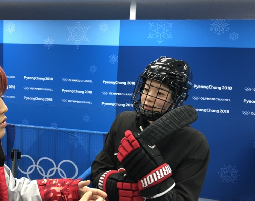 Japanese women's hockey defenseman Shiori Koike speaks to reporters after practice at Kwandong Hockey Centre in Gangneung Gangwon Province on Feb. 9 2018