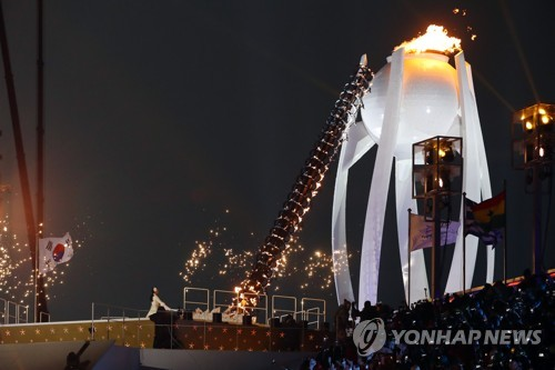 The Olympic Cauldron for the 2018 PyeongChang Winter Games is lit by former figure skating gold medalist Kim Yu-na during the opening ceremony at PyeongChang Olympic Stadium on Feb. 9, 2018. (Yonhap)