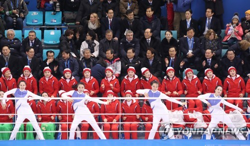 North Korean cheerleaders perform their routine in support of the joint Korean women's hockey team during a game against Switzerland during their Group B contest of the women's hockey tournament at the Pyeong Chang Winter Olympics at Kwandong H