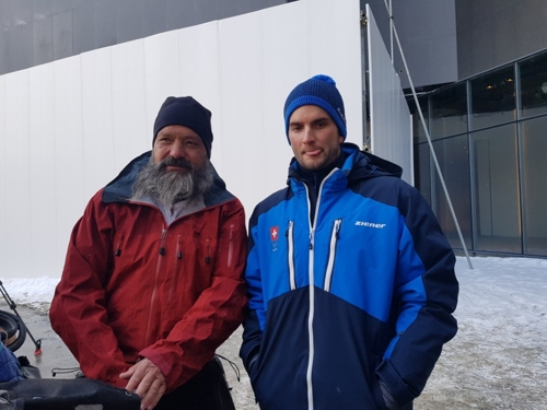 Guido Huwiler (L) and his son Mischa Gasse pose for a photo at Phoenix Snow Park in PyeongChang, Gangwon Province, on Feb. 13, 2018. Guido travelled 17,000 kilometers by bicycle to see his son, an aerial skier, competing at the Winter Olympic Games. (Yonhap)