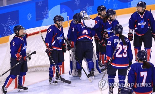 Members of the joint Korean women's hockey team console each other after a 4-1 loss to Japan in Group B game of the women's tournament at the Pyeong Chang Winter Olympics at Kwandong Hockey Centre in Gangneung Gangwon Province on Feb. 14 2018