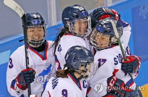 Members of the joint women's ice hockey team of the two Koreas congratulate each other in their match with Sweden at Kwandong Hockey Centre located in Gangneung around 240 kilometers east of Seoul on Feb. 20 2018