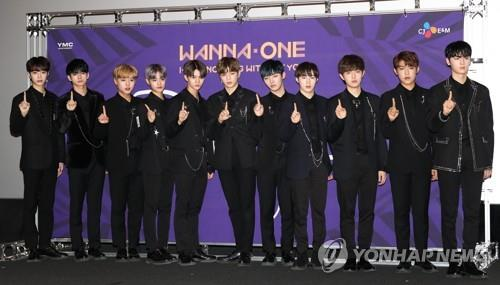"""The K-pop project boy group Wanna One poses for photos before a press conference for its repackaged album """"1-1=0 Nothing Without You"""" at the CGV in Yongsan, Seoul, on Nov. 13, 2017. (Yonhap)"""