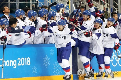US, Norway, Finns, Germans in Olympic hockey quarters