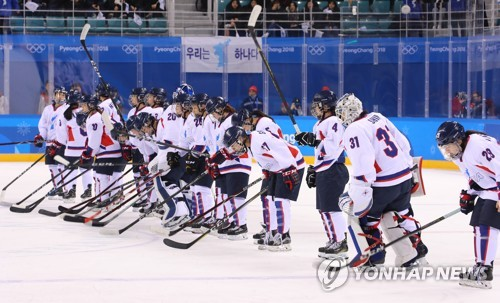 Players of the joint Korean women's hockey team salute the crowd at Kwandong Hockey Centre in Gangneung Gangwon Province on Feb. 20 2018