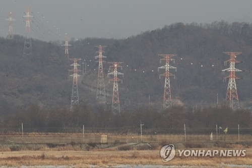 Power lines for the shuttered joint industrial complex in North Korea's border city of Kaesong are seen from across the Imjin River which runs across the inter Korean border in the South Korean city of Paju north of Seoul on Jan. 4 2018. (Yonhap