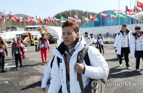 South Korea's ice sledge hockey player Jung Seung-hwan enters the athletes&apos village for the Pyeong Chang Paralympics in PyeongChang Gangwon Province