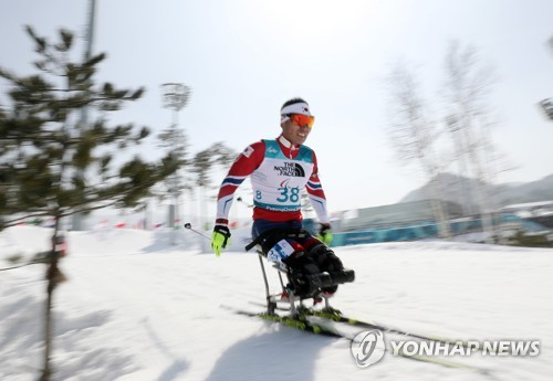South Korean Nordic para skier Sin Eui-hyun competes in the men's 7.5-kilometer sitting biathlon event at the Pyeong Chang Winter Paralympic Games at Alpensia Biathlon Centre in PyeongChang Gangwon Province