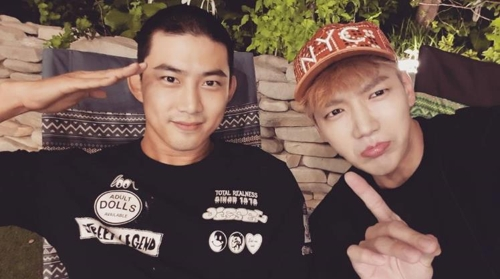 This image, captured from the Instagram account of 2PM member Jun. K (R), shows bandmate Ok Taecyeon (L) rocking a military-style hair cut before entering the Army on Sept. 4, 2017. (Yonhap)