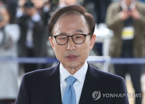 Former South Korean president Lee appears for questioning over graft charges