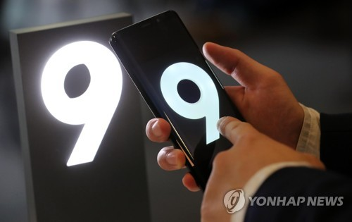 A visitor takes a look at the Galaxy S9 smartphone at a retail shop in Seoul