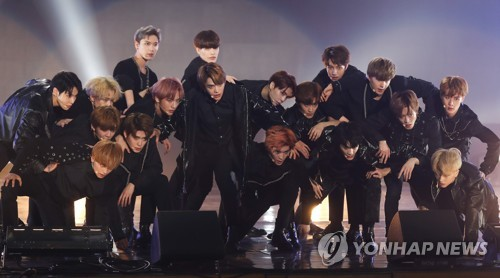 """In this file photo, NCT performs during a showcase for the group's new album """"NCT 2018 Empathy"""" at Korea University's Hwajung Gymnasium in Seoul on March 14, 2018. (Yonhap)"""