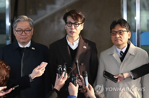 Yun Sang, South Korea's chief delegate for inter Korean working-level talks on a South Korean art troupe's proposed concert in Pyongyang speaks to reporters