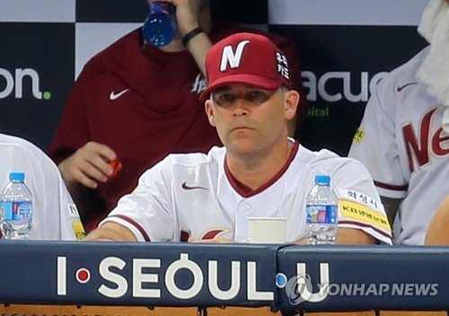 In this file photo taken on Aug. 1, 2017, Brandon Knight, pitching coach for the Nexen Heroes, watches a Korea Baseball Organization regular season game against the SK Wyverns at Gocheok Sky Dome in Seoul. (Yonhap)