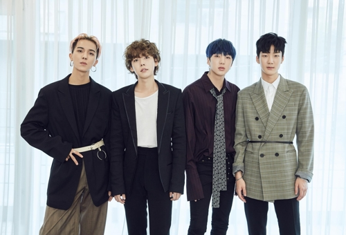 """This photo provided by YG Entertainment shows members of K-pop band WINNER posing for photos during a group media interview for their latest album, """"EVERYD4Y,"""" on April 4, 2018, in Seoul."""