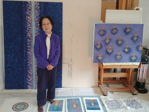 South Korean artist Bang Hai-ja poses for a photo at her studio at Youngeun Museum in Gwangju on the outskirts of Seoul, where she has been taking an art residency program, on April 6, 2018. (Yonhap)