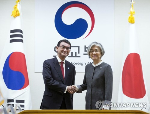 Japan, S.Korea agree to maintain pressure