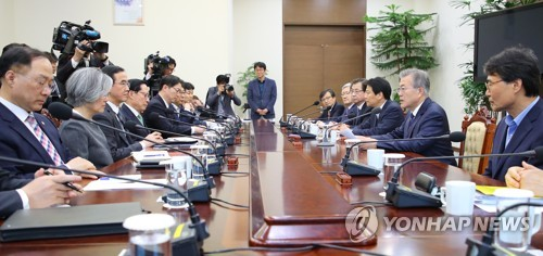 In the photo, taken April 11, 2018, President Moon Jae-in (2nd from R) is seen speaking at meeting of a preparation committee for his upcoming summit with North Korean leader Kim Jong-un, held at his office Cheong Wa Dae in Seoul. (Yonhap)
